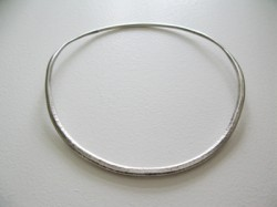 hammered silver torque style choker with invisible pressure fastener