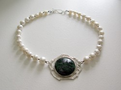 feature stone and silver pendant on a knotted pearl necklace