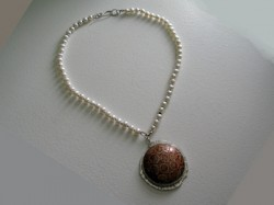 pearl necklace featuring a fossil stone